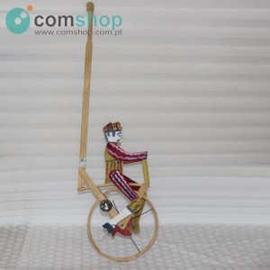 Doll on wheel pedaling...